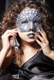 Woman with silver rhinestone mask Stock Photography