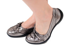 Woman in silver shoes Stock Photography