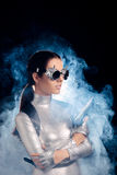 Woman in Silver Space Costume Holding Pistol Gun Royalty Free Stock Photo