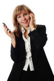 Woman simultaneously talking on two phones. Cheerful business-woman simultaneously talking on two wireless phones Stock Photos