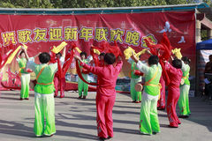 Woman sing and dance to celebrate the chinese new year Stock Image