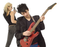 Woman singer and male guitarist in foreground Royalty Free Stock Image