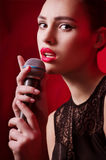 Woman singer with microphone Stock Photos