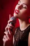 Woman singer with microphone Stock Photography