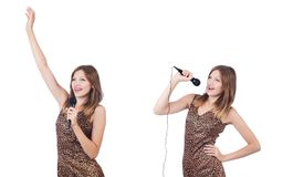 The woman singer with microphone on white. Woman singer with microphone on white royalty free stock photo