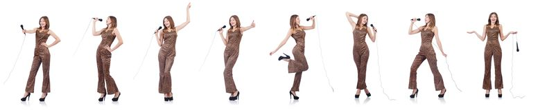 The woman singer with microphone on white. Woman singer with microphone on white stock photo