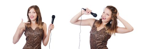 The woman singer with microphone on white. Woman singer with microphone on white royalty free stock photography