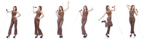 The woman singer with microphone on white. Woman singer with microphone on white stock photography