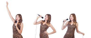 The woman singer with microphone on white. Woman singer with microphone on white stock image