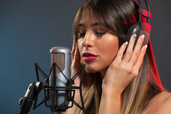 Woman Singer Recording A Ballad Stock Images