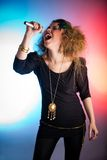 Woman singing Stock Images