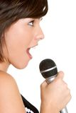 Woman Singing. Beautiful young woman singing karaoke stock images