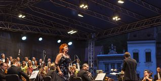 Classical Concert in Brasov. Woman singing aria on stage on a classical concert in Old Town Braşov, Romania Stock Photography