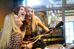 Woman singing, band playing instruments royalty free stock image