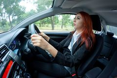Woman singing in a car Royalty Free Stock Image