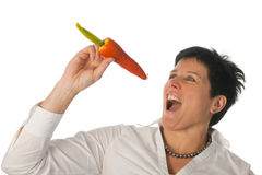 Woman singing with a carrot Royalty Free Stock Photo