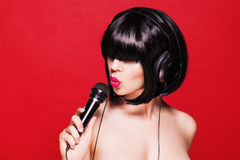 Woman singing. Closeup portrait of beautiful girl Royalty Free Stock Images