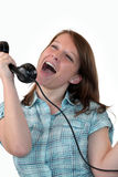 Woman singing down phone Royalty Free Stock Photos