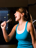woman is singing at evening gym Royalty Free Stock Images