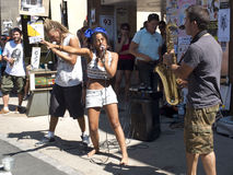 Woman singing face to face a saxophonist. Stock Photos