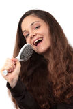 Woman singing in hairbrush Royalty Free Stock Photography