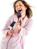 Woman singing with hairbrush Stock Photos