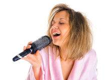 Woman singing with hairbrush Royalty Free Stock Images