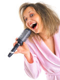 Woman singing with hairbrush Royalty Free Stock Photo