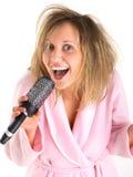 Woman singing with hairbrush Stock Image