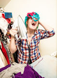 Woman singing and having fun during ironing Stock Image