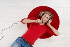 Woman singing with headset Royalty Free Stock Images
