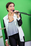 Woman Singing While Holding Microphone In Stock Photos
