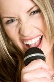 Woman Singing Karaoke Stock Image