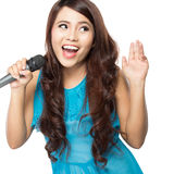 Woman singing karaoke Royalty Free Stock Photography