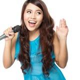 Woman singing karaoke. Beautiful stylish woman singing karaoke isolated over white background Royalty Free Stock Photography