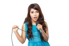 Woman singing karaoke. Beautiful stylish woman singing karaoke isolated over white background Royalty Free Stock Photo