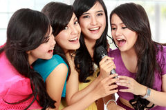 Woman singing karaoke together Stock Photo