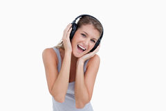 Woman singing while listening to music Stock Photo