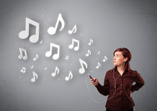 Woman singing and listening to music Stock Images