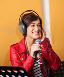 Woman Singing While Looking Away In Recording Studio Royalty Free Stock Photo