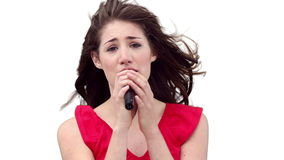 Woman singing while looking at the camera Royalty Free Stock Image