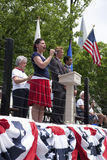 Woman singing on Memorial Day Stock Image
