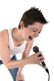 Woman singing into a microphon. Beautiful woman singing into a microphone isolated on white background Stock Photos