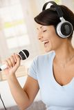 Woman singing with microphone Stock Photography