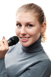 Woman singing into a microphone Royalty Free Stock Images
