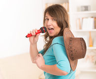 Woman singing with a microphone Stock Photography