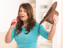 Woman singing with a microphone Stock Photos