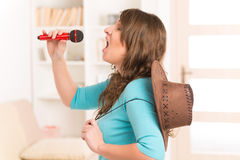 Woman singing with a microphone Stock Images