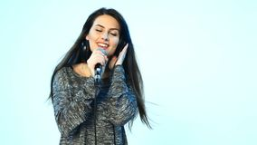 Woman singing in microphone and dancing stock video footage