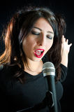 Woman Singing With Microphone royalty free stock photography